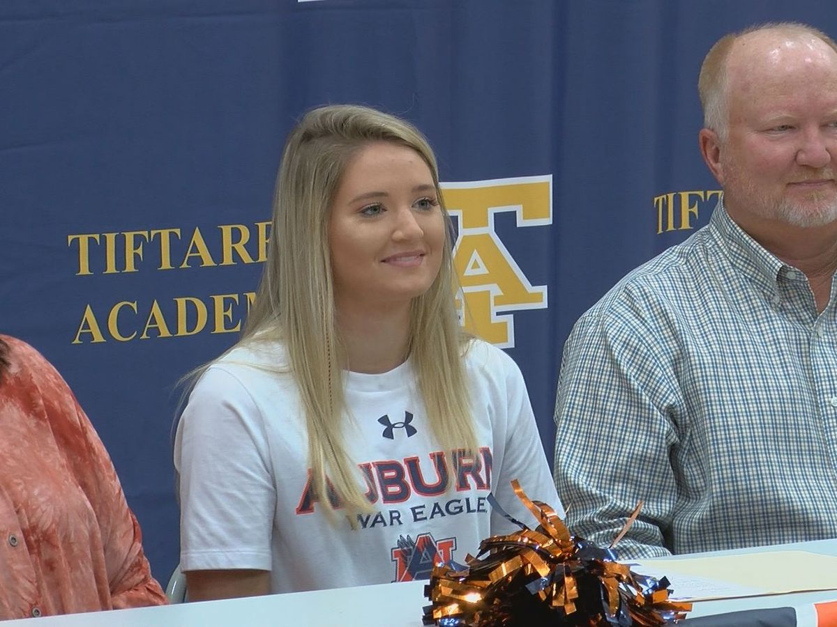 Anna Sumner signs her letter of intent to continue her gymnastics career at Auburn