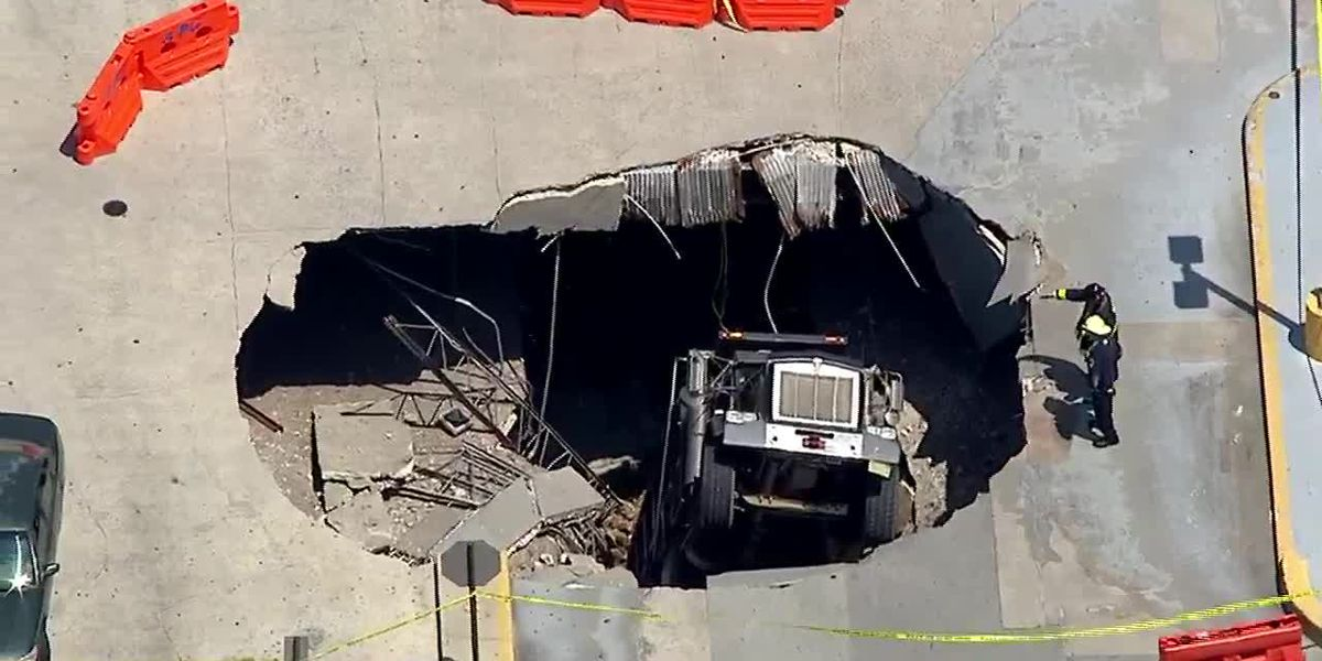 Truck falls through upper deck of parking garage in New Jersey