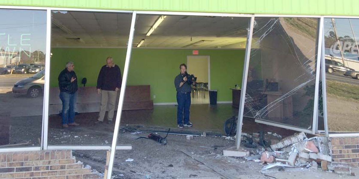 Car crashesthrough store front; Driver identified
