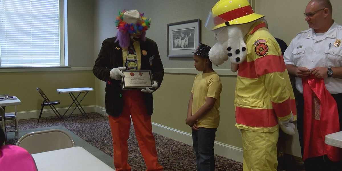 8 year old boy honored as a hero