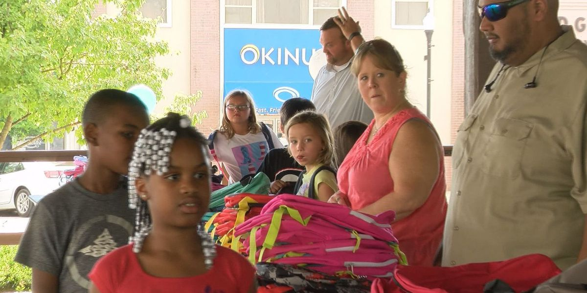 Pelham business hosts book bag giveaway for Mitchell Co. students