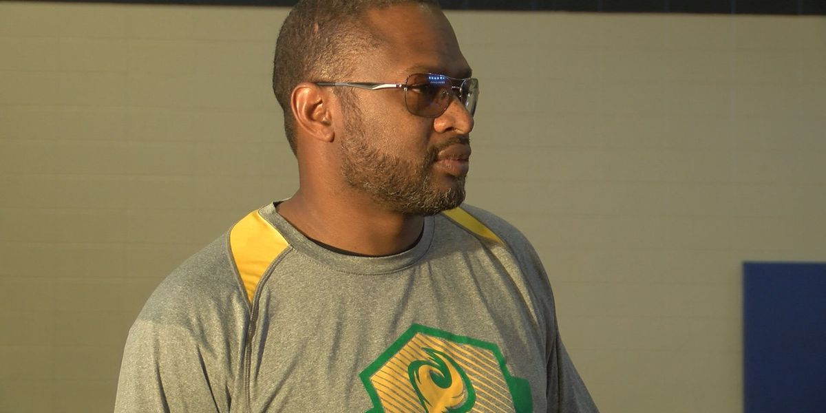 Former Monroe basketball coach fights to get his job back