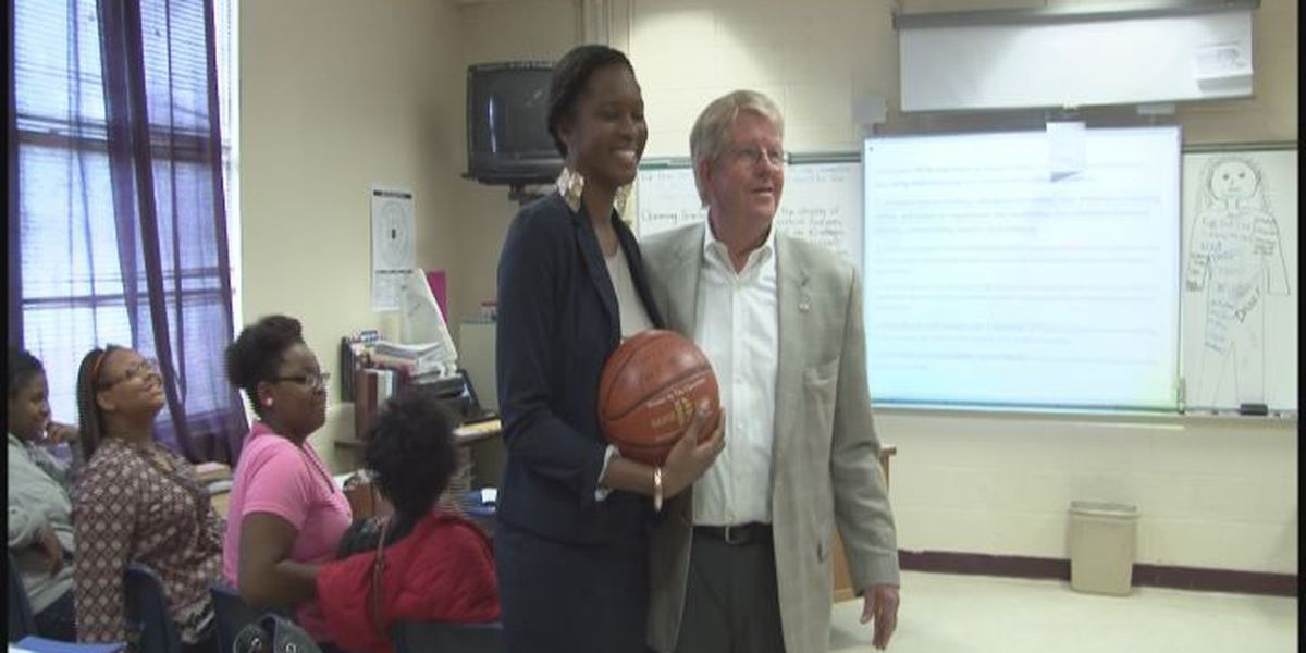 Superintendent hands out Game balls to teachers
