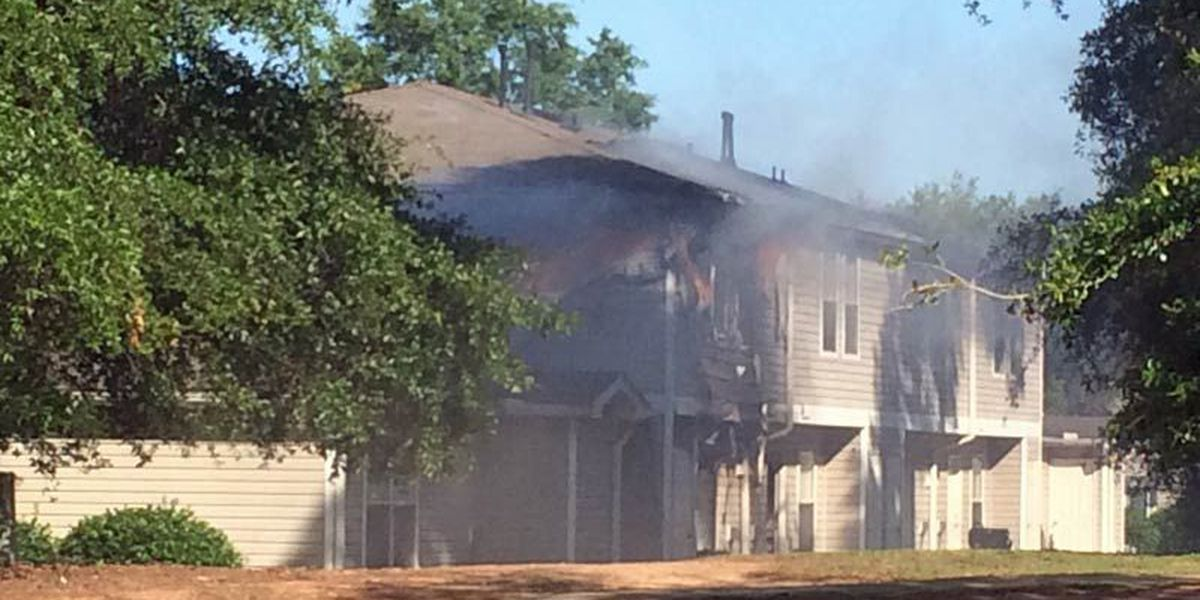 Apartment building partially burns