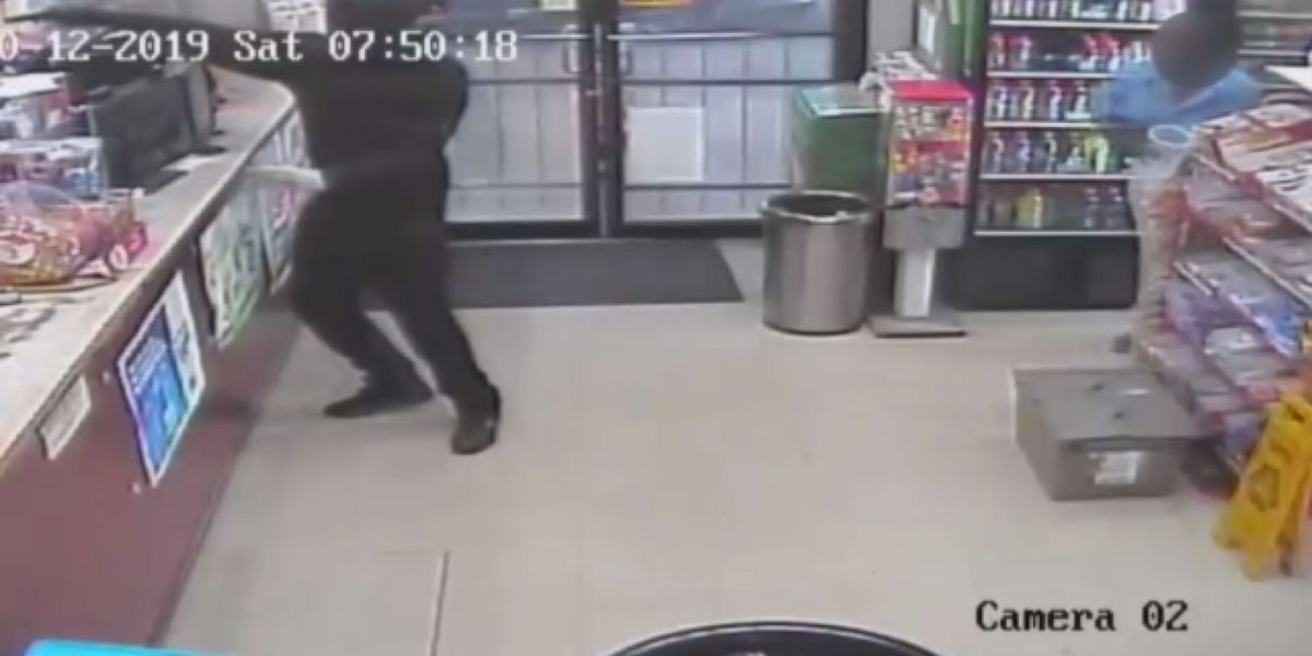 Search underway for man caught on camera robbing Clark Avenue store