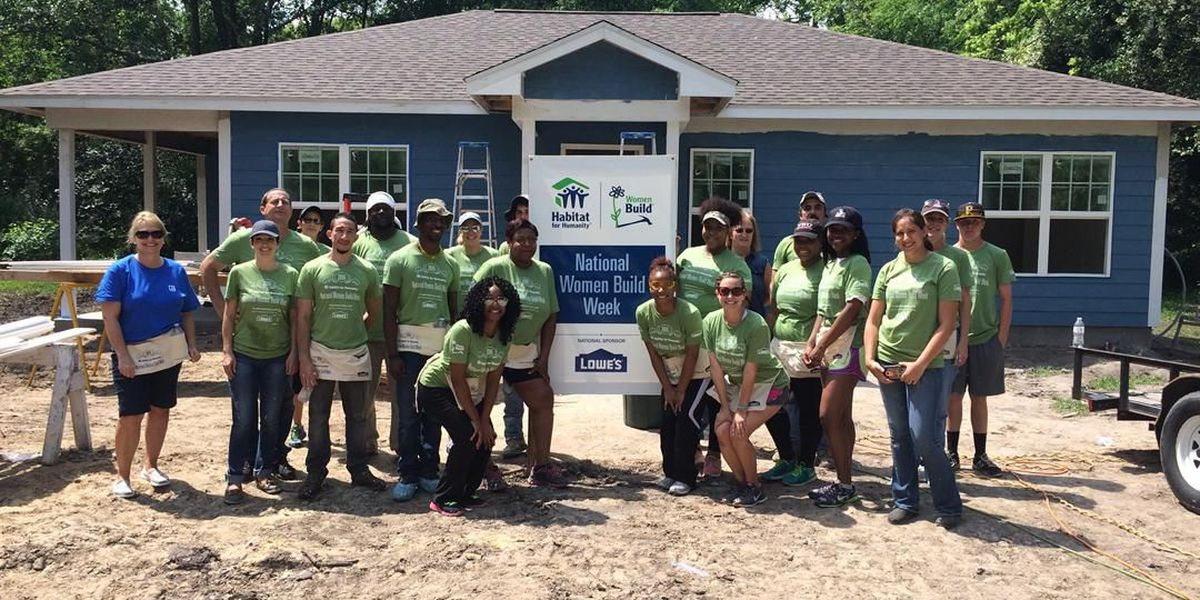 Volunteers celebrate National Women Build Week by helping families