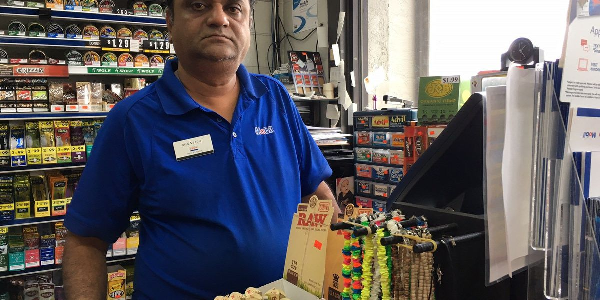 Gas station clerk robbed at gunpoint
