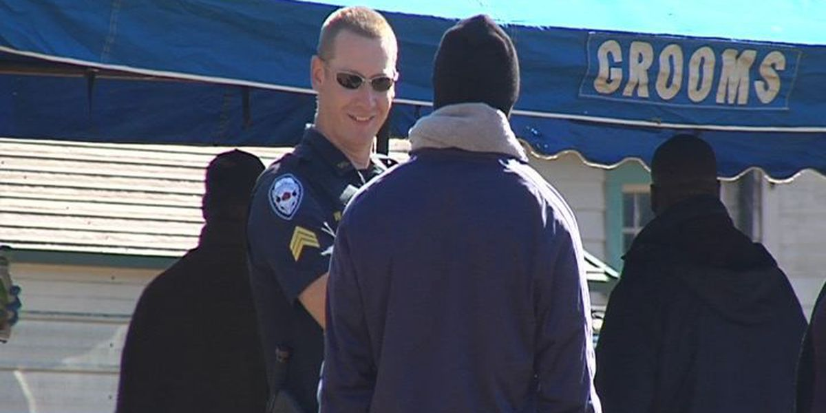 Police officers join neighborhood Thanksgiving feast