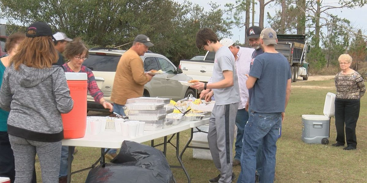 Volunteers feed community, clear debris