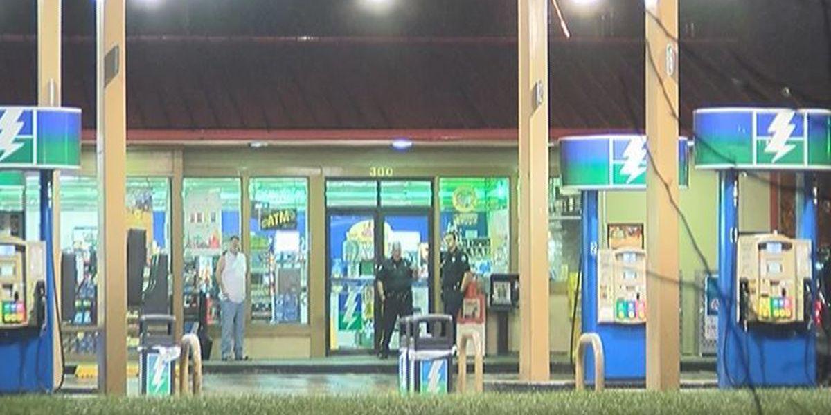 Armed robber grabs cash at Flash Foods