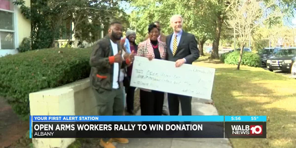 Open Arms workers rally to win donation