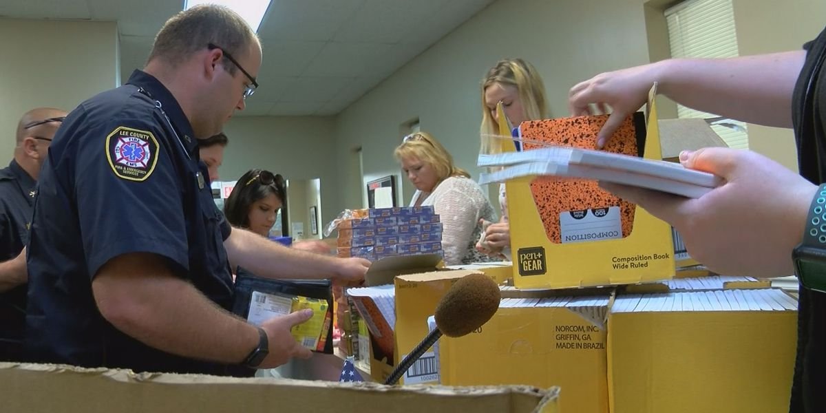 Lee Co. officials fill backpacks for back to school bash