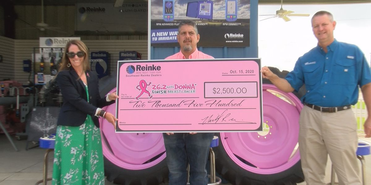 Reinke Manufacturing donates $2,500 to breast cancer foundation