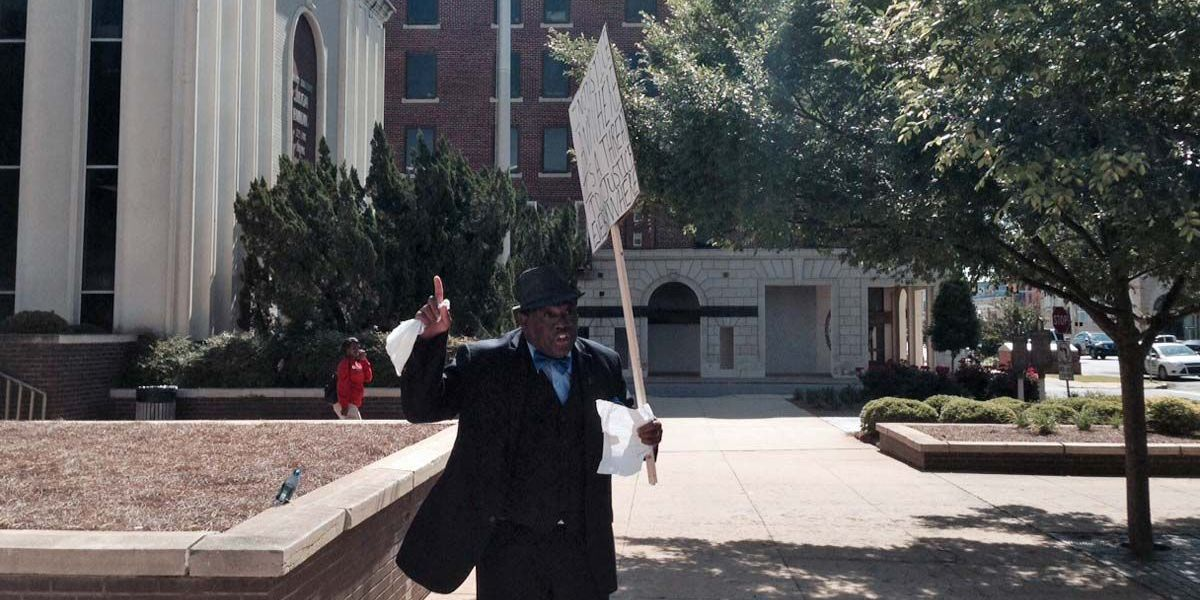 Men protest in downtown Albany