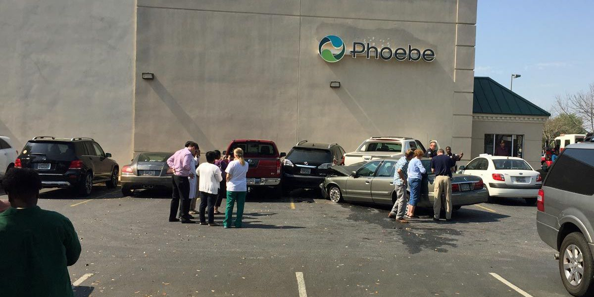 Woman hits several cars in parking lot, injures two