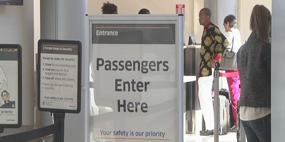 Travelers flying out of Albany are cautious about Ebola