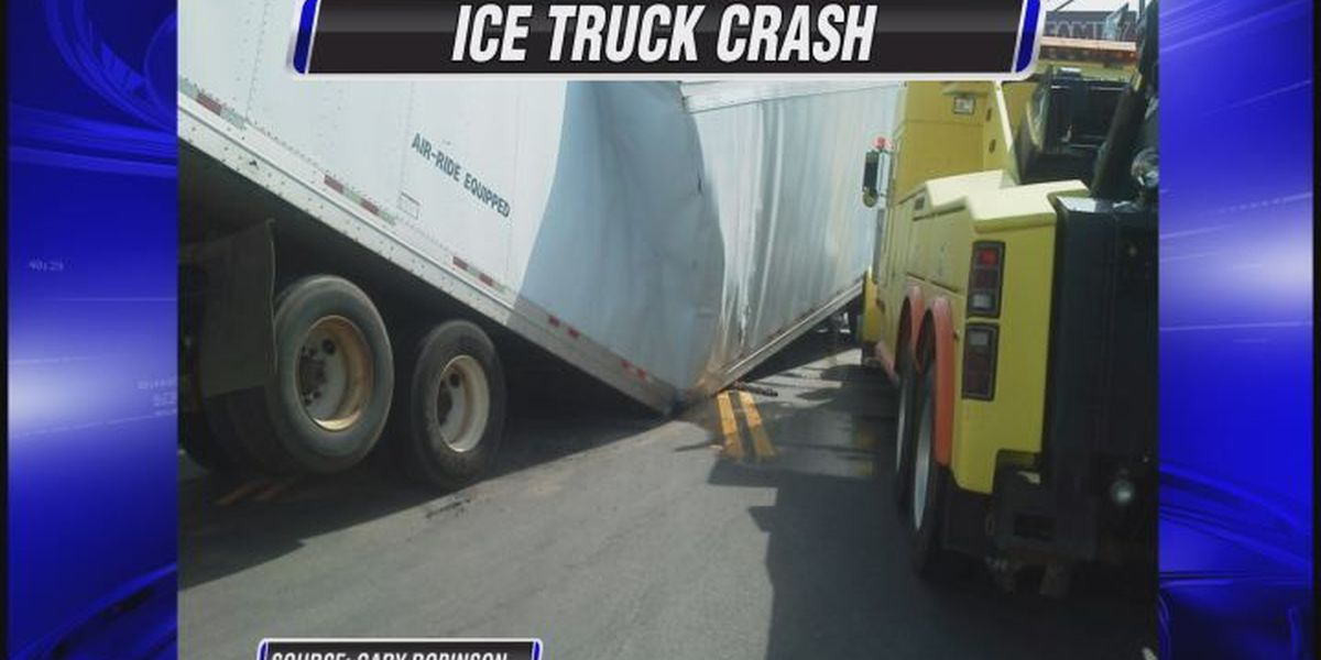 Trailer snaps in half and spills ice on the road in Omega