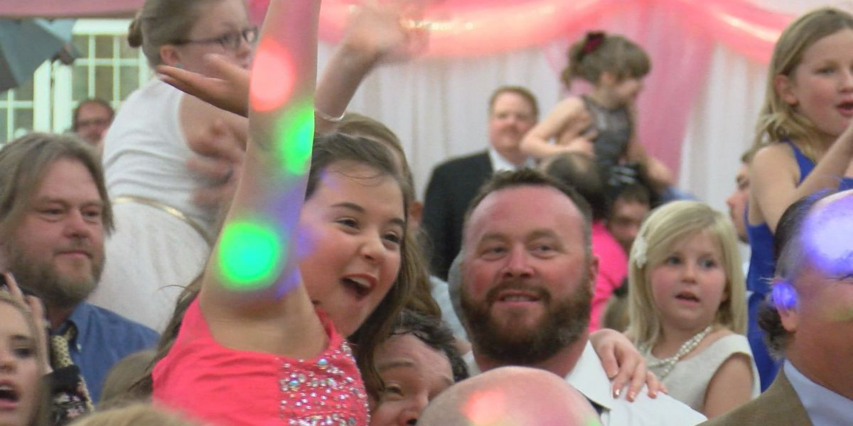 Lee Co. dads show Valentine's Day love to daughters at annual dance
