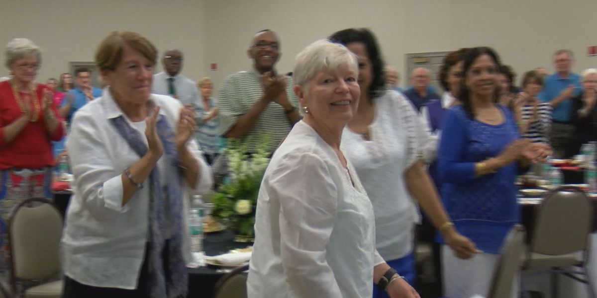 A hospital volunteer is honored for 23+ years of service