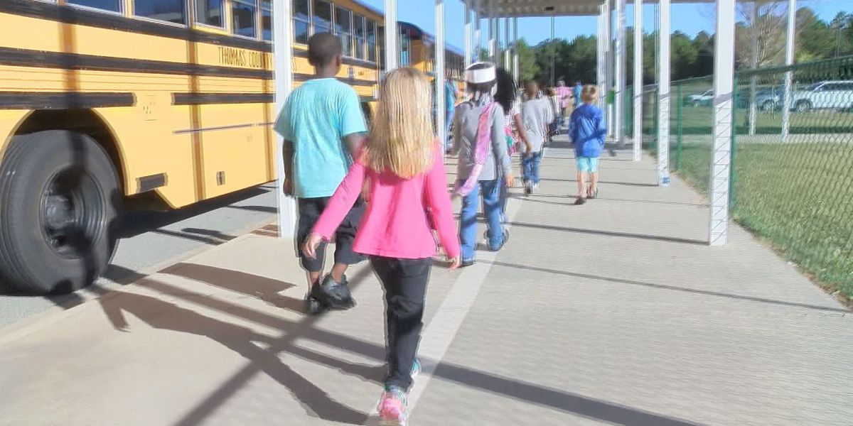 Kids learn bus safety on a field trip to the park