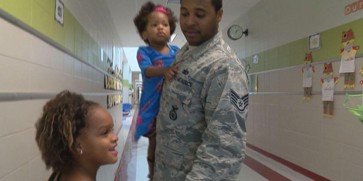 Students wear purple to salute military classmates