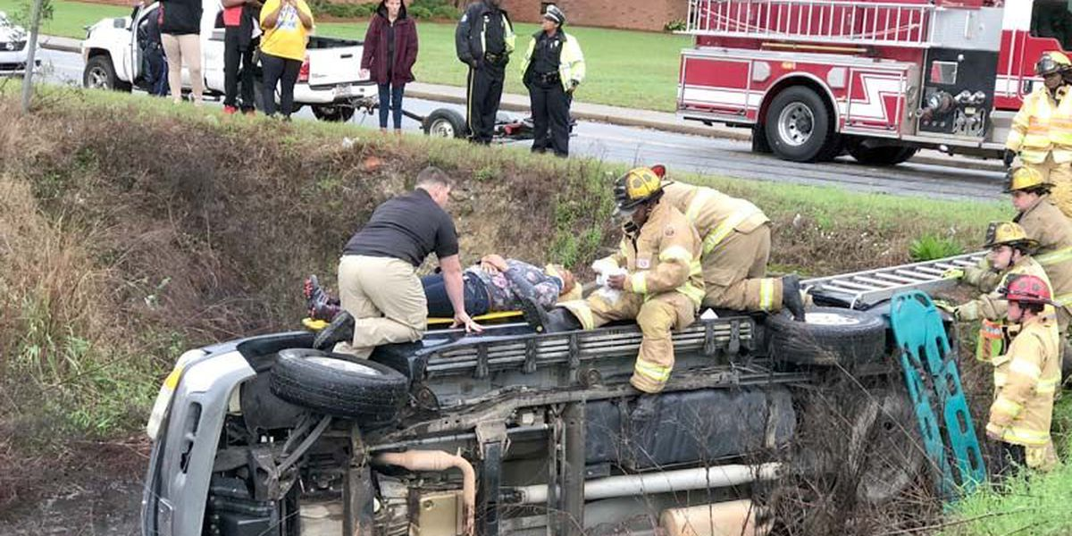 Woman rescued from vehicle in a water-filled ditch