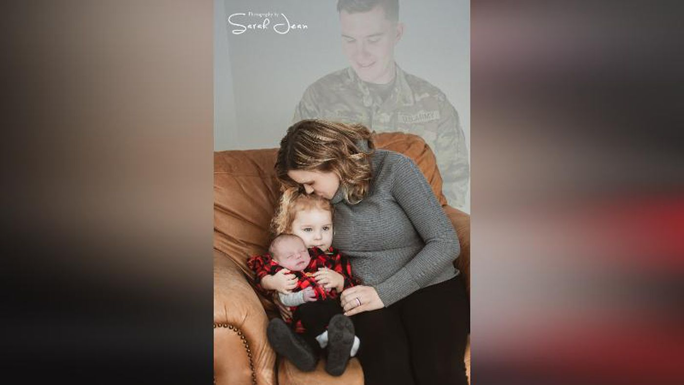 Soldier dad added to family pictures, overlooks infant son born after his death